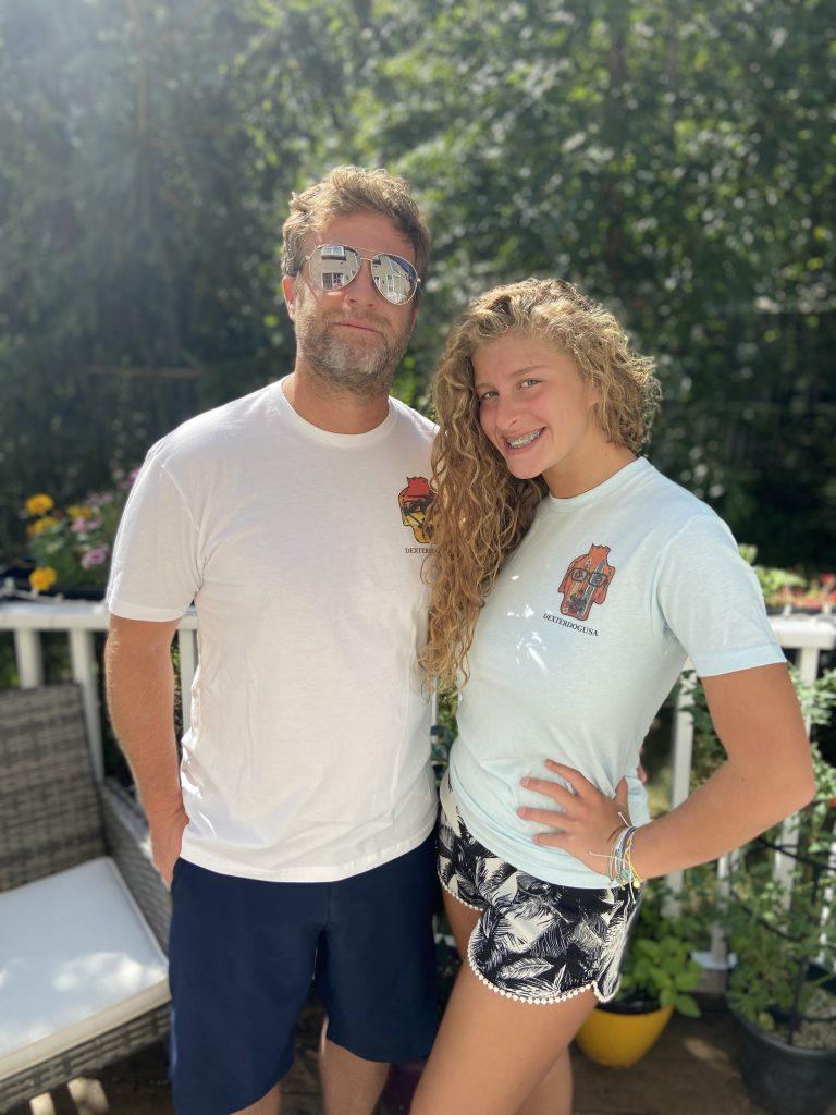 Man and woman wearing DexterDogUSA beachwear