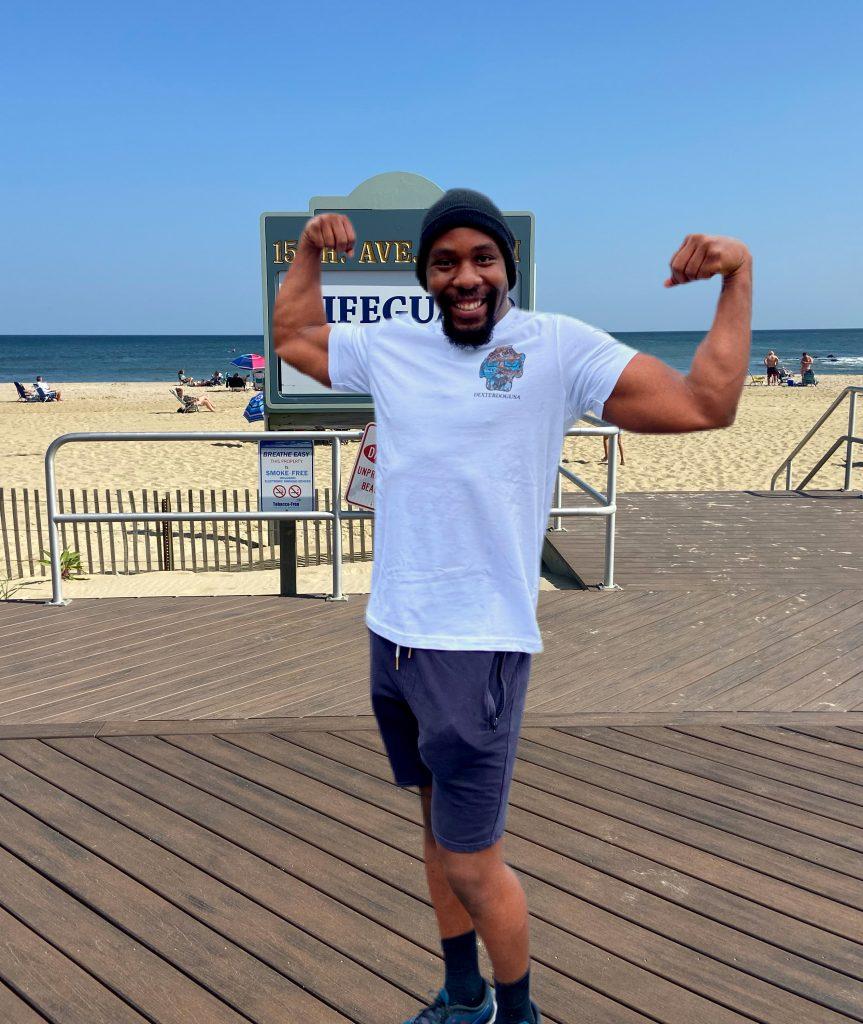 Man modeling DexterDogUSA Beachwear on Belmar Beach Boardwalk