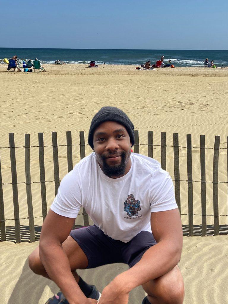 Man on beach wearing DexterDogUSA Tshirt