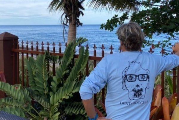 Man wearing long sleeve DexterDogUSA shirt in tropical location