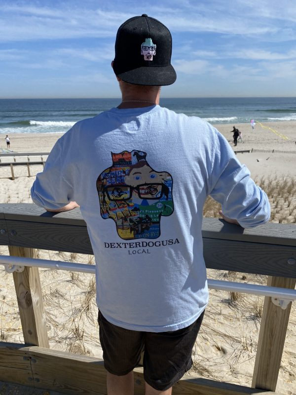 Man wearing DexterDogUSA Long Sleeve Tee and Hat on boardwalk at the beach